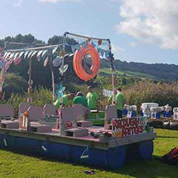 blue raft with bunting regatta event highlight