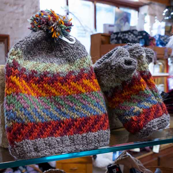 grey and orange knitted chevron bobble hat and mittens set