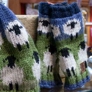 white sheep pattern knitted mittens and hat detail