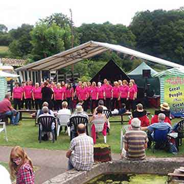 folk festival singers in pink in event highlight