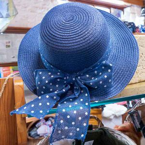 light blue straw hat with white dotted ribbon