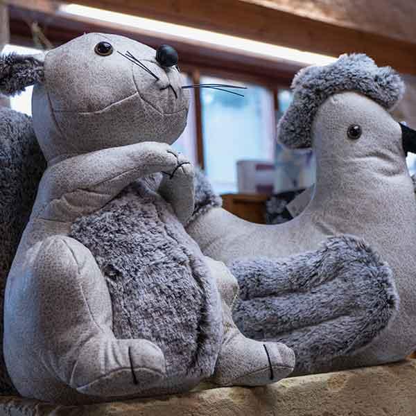 grey fabric and faux fur novelty hen door stop