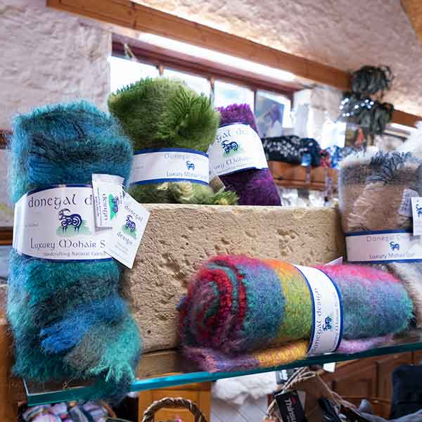 luxury Donegal mohair scarves in turquoise, green and purple