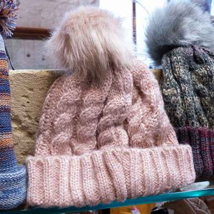 pale pink cable knit fluffy pom pom bobble hat
