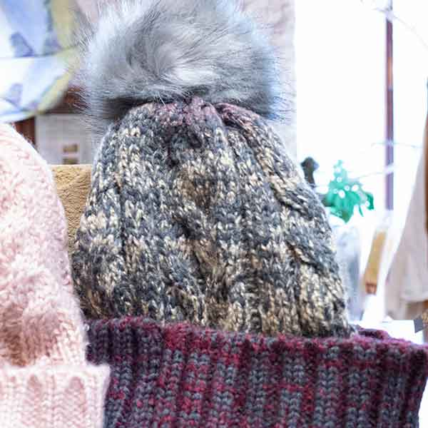 grey and mauve cable knit fluffy pom pom bobble hat