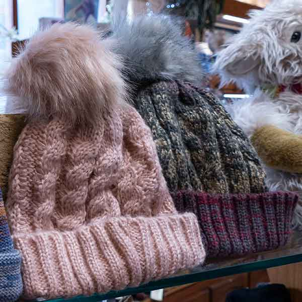 pale pink and grey cable knit fluffy pom pom bobble hatcable knit fluffy pom pom bobble hats