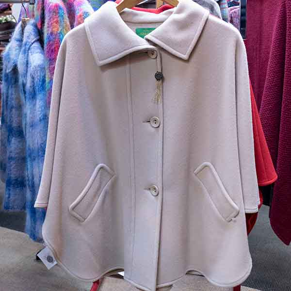 Single colour ivory wool cape with pockets