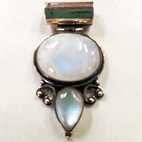 Double polished crystal pendant with decorative sterling silver setting