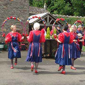 ladies with flower hoops in country dancing event highlight