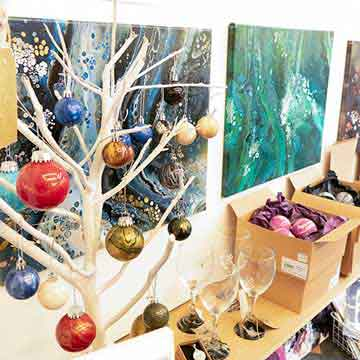 boat house baubles and painted canvases in vibrant colours