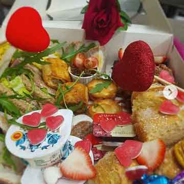 afternoon tea box with red rose and heart sweets and decorations