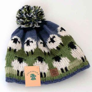 white sheep pattern knitted bobble hat
