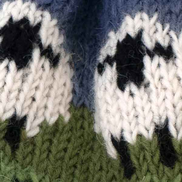 white sheep pattern knitted bobble hat detail