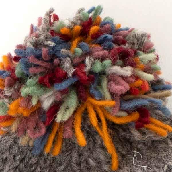 grey and orange knitted chevron bobble hat pom pom detail