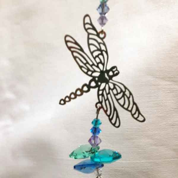 dragonfly silhouette light catcher with hanging blue and green glass crystals, top detail