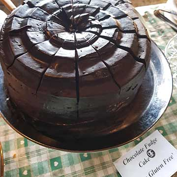 complete gluten free chocolate fudge cake cut into slices