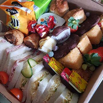 kids afternoon tea box with sandwiches and cakes