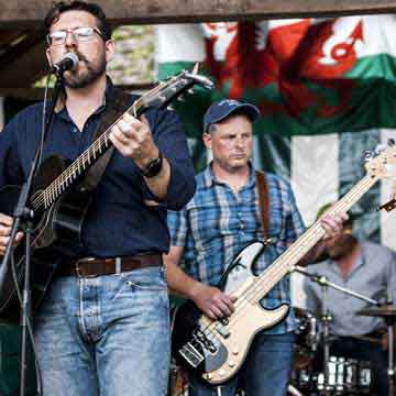 Mud on the Tyres band and Welsh flag at recent events