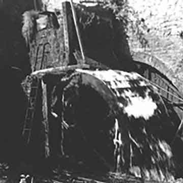 black and white photograph of the working water wheel