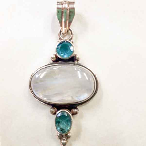polished crystal and turquoise pendant in sterling silver setting