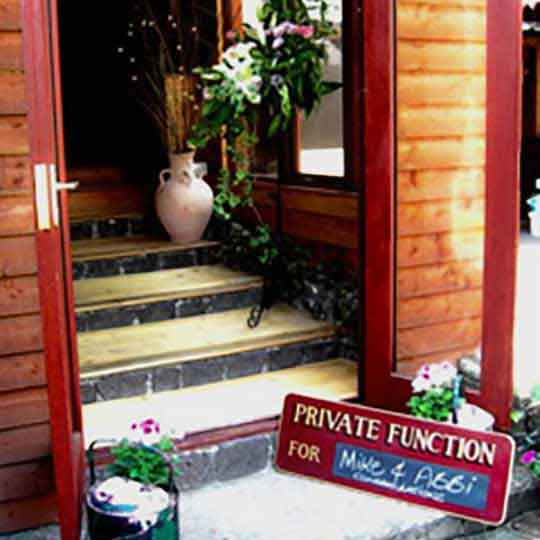 private function room entrance and signage with flowers