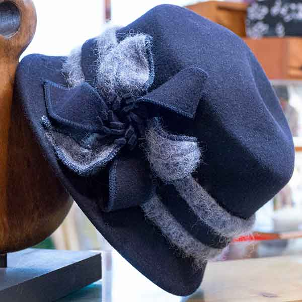 blue felt cloche hat with grey fluffy band and bow
