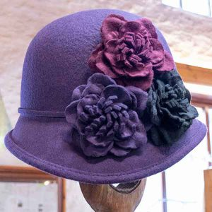 purple felt cloche hat with three contrasting flowers