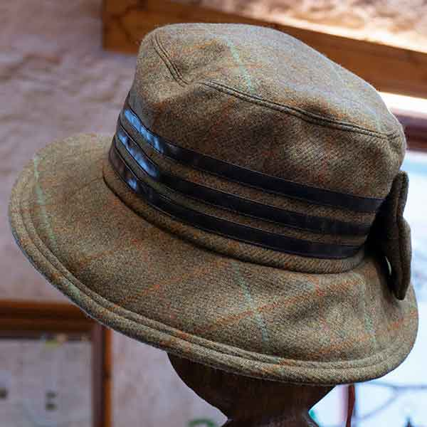 tweed hat with fabric bow and triple band and triple leather band view