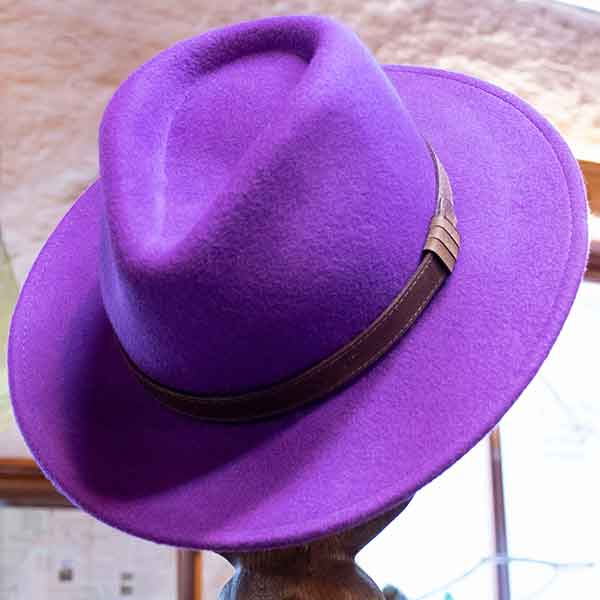 mauve fabric trilby hat with brown leather band