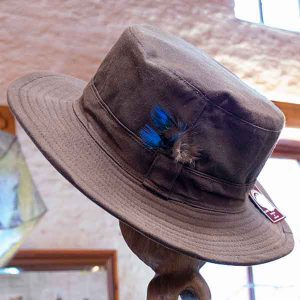 brown canvas hat with blue and brown feathers