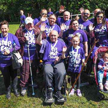 stroke CMYRU Wales group in purple t- shirts at recent event