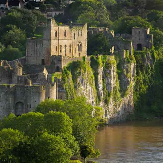 Chepstow Castle fortifications in the sunshine by the River Wye