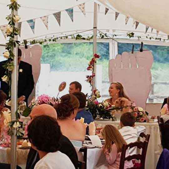 wedding function marquee with bunting and flowers