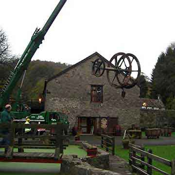 crane moving the refurbished the old abbey mill water wheel
