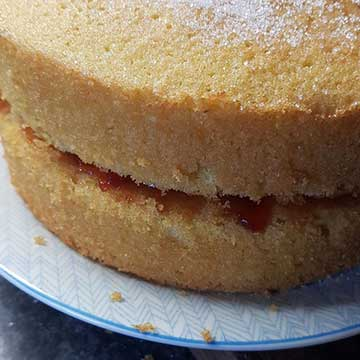 close up of home made sponge cake with jam filling