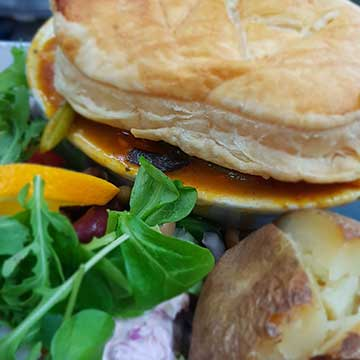 Woodsaw & Wheel puff pastry meat pie with baked potato and salad