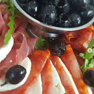 outside catering with summer olives and cooked meats and cheese